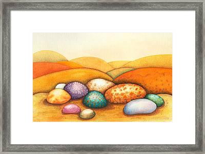 Pebbles Framed Print by Sandra Moore