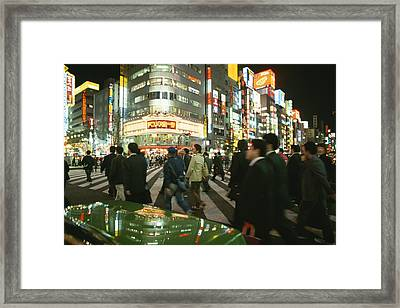 Pedestrians Cross A Crowded Tokyo Framed Print by Justin Guariglia