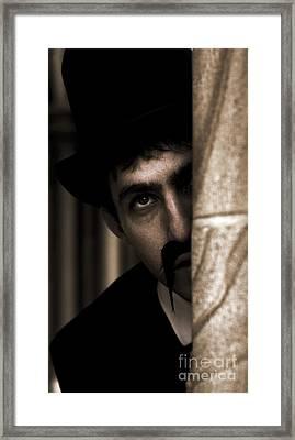 Peeking Pastor Pillar Framed Print
