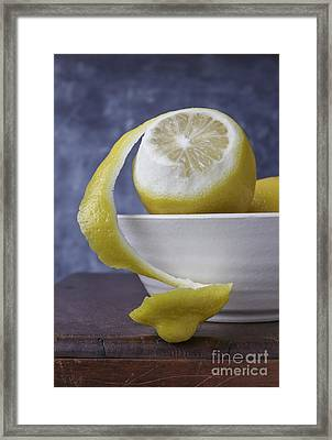 Peeled Lemon In Bowl Framed Print by Edward Fielding