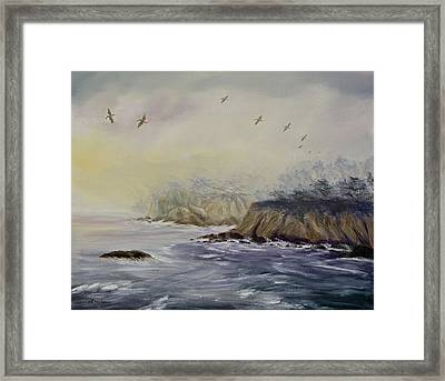 Pelicans On A Misty Morning Framed Print by Laura Iverson