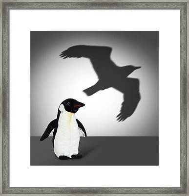 Penguin With Eagle Shadow. Concept Graphic Framed Print by Cranach Studio