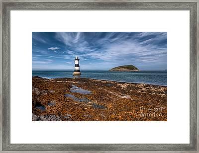 Penmon Lighthouse Framed Print by Adrian Evans