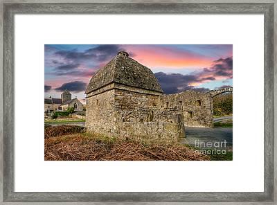 Penmon Priory Sunset Framed Print by Adrian Evans