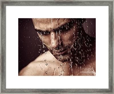 Pensive Man Face Under Showering Water Framed Print by Oleksiy Maksymenko