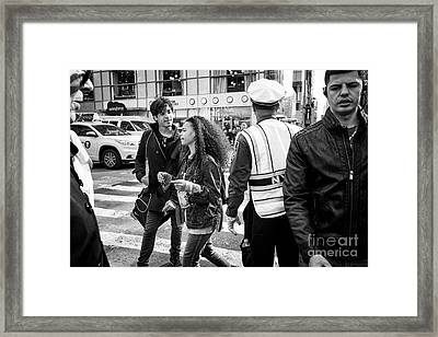 people crossing road busy intersection New York City USA Framed Print