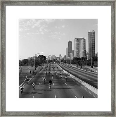 People Cycling On A Road, Bike The Framed Print by Panoramic Images