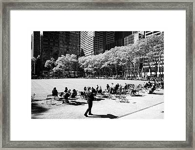 People Eating Lunch Sitting In The Chairs In Bryant Park New York City Usa Framed Print