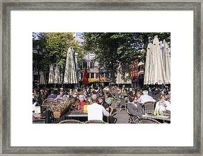 People Enjoying S Sunny Day In Amsterdam Framed Print