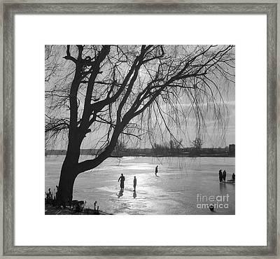 People Ice Skating On A Frozen Over Lake Framed Print