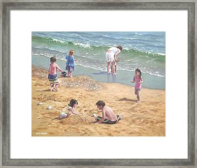 people on Bournemouth beach kids in sand Framed Print