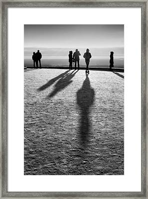 People Standing Looking In Winter With Their Shadows Framed Print by John Williams