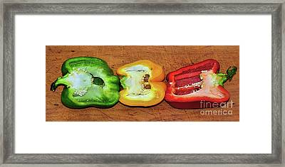 Framed Print featuring the photograph Peppers In A Row By Kaye Menner by Kaye Menner
