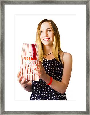 Person At Movie Cinema With Popcorn Bag Framed Print by Jorgo Photography - Wall Art Gallery