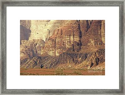 Person Riding A Motorbike Through The Wadi Rum Desert In Jordan Framed Print by Sami Sarkis