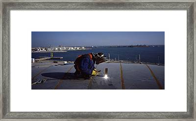 Person Welding In A Chemical Plant Framed Print