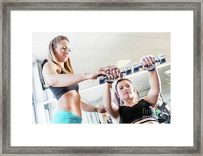 Personal Trainer Assistance During Fatburning Exercise. Framed Print
