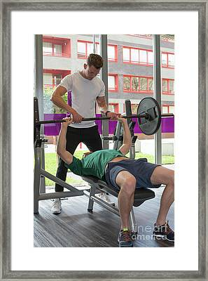 Personal Trainer At Work With Man Framed Print