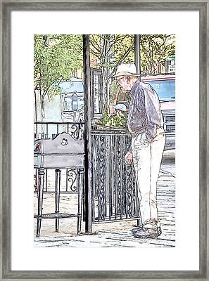 Perusing The Menu Framed Print by John Haldane