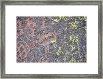 Petroglyph Wolf Attack Framed Print