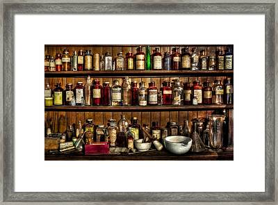 Pharmaceuticals Framed Print by Susan Candelario