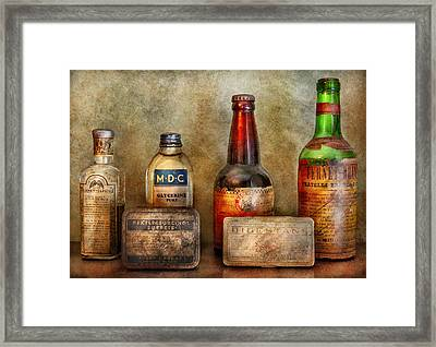 Pharmacist - On A Pharmacists Counter Framed Print by Mike Savad