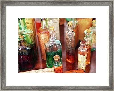 Pharmacist - The Druggist And His Cures Framed Print