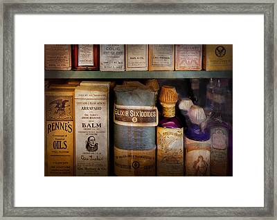 Pharmacy - Oils And Balms Framed Print by Mike Savad