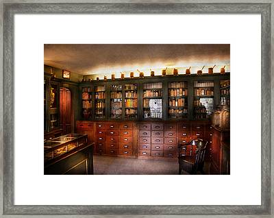 Pharmacy - The Apothecary Shop Framed Print by Mike Savad