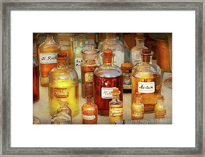Pharmacy - Serums And Elixirs Framed Print by Mike Savad