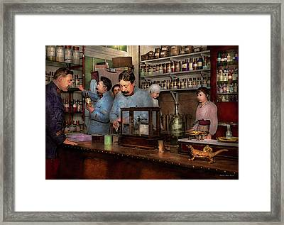 Framed Print featuring the photograph Pharmacy - The Dispensing Chemist 1918 by Mike Savad