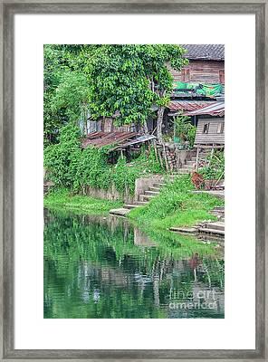 Phetchaburi River Shacks Framed Print by Antony McAulay