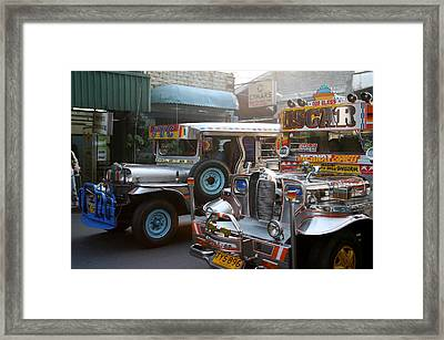 Philippine Jeepneys.  Framed Print by Christopher Rowlands