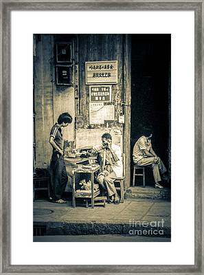 Framed Print featuring the photograph Phonecall On Chinese Street by Heiko Koehrer-Wagner