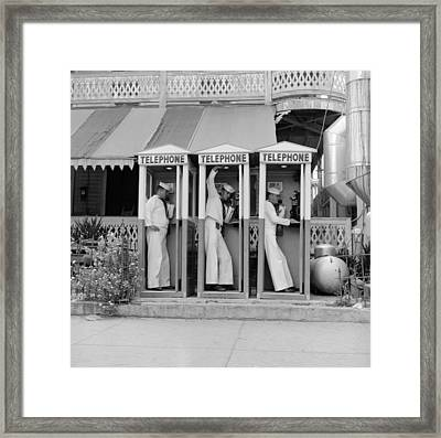 Phoning Sailors Framed Print by Efield
