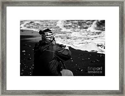photographer taking photos of Ice washed up on black sand beach at jokulsarlon iceland Framed Print