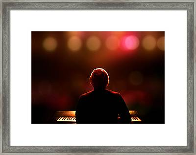 Pianist On Stage From Behind Framed Print