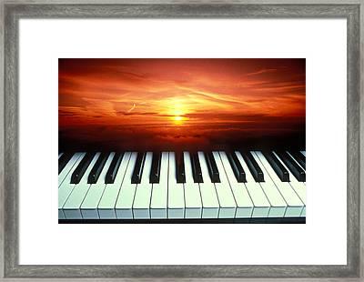 Piano Keys Sunset Framed Print by Garry Gay