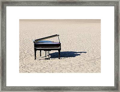 Piano On Beach Framed Print
