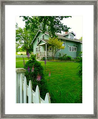 Picket Fence Flowers Framed Print by Lori Seaman