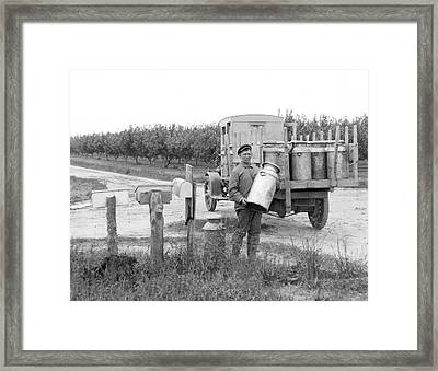 Picking Up Milk Cans Framed Print by Underwood Archives