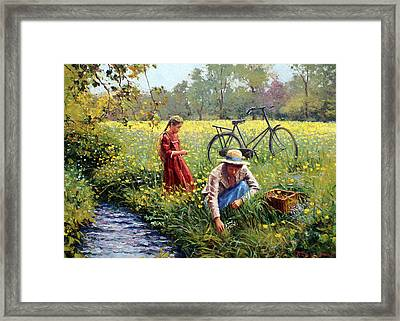 Picking Yellow Flowers Framed Print