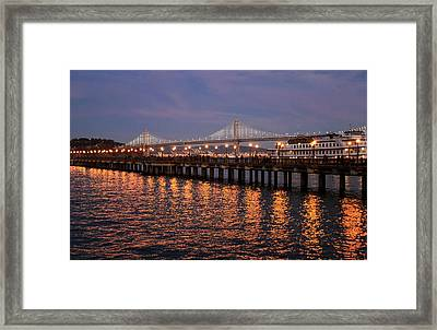 Pier 7 And Bay Bridge Lights At Sunset Framed Print