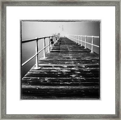 Pier At Pooley Bridge On Ullswater In The Lake District Framed Print