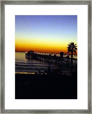 Framed Print featuring the photograph Pier At Sunset by Amanda Eberly-Kudamik