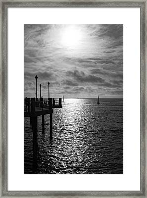Framed Print featuring the photograph Pier Into The Sun by Michael Hope