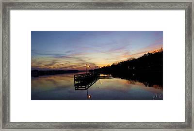 Pier Silhouetted In The Sunset On The Coosa River Framed Print