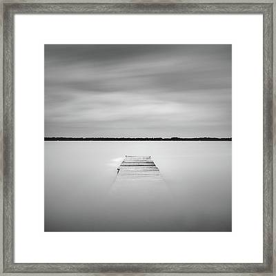 Framed Print featuring the photograph Pier Sinking Into The Water by Todd Aaron
