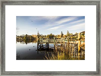 Piers And Peaceful Blue Waters Framed Print by Jorgo Photography - Wall Art Gallery