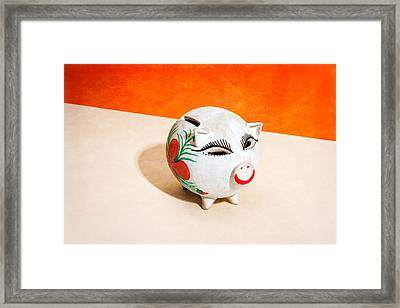 Piggy Bank Wink Framed Print by Yo Pedro